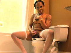 Ebony tgirl tugging the brush cock in all directions the bathroom