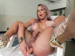 Tanlined latina tgirl tugging adjacent to bathroom
