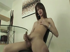 Thai she-male with rock-hard trouser snake shoots jizz