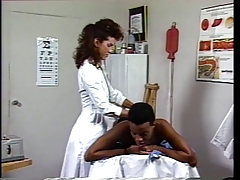 Doctor gets horny to inhale ample thick ebony meatpipe on the couch