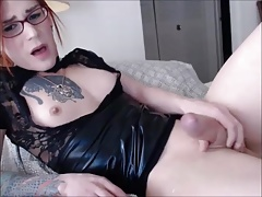 Redhead tgirl with glasses shoots